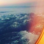 Somewhere over Colorado sunset reflecting on the window airplane mountains
